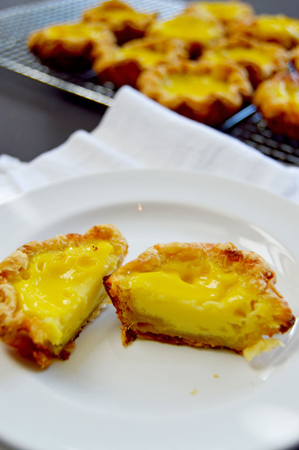 Hong Kong Egg Tarts - a popular pastry in China, Taiwan, Macau, Hong Kong and at dim sum restaurants. An easy and delicious taste of Asia! | www.TheHungryTravelerBlog.com
