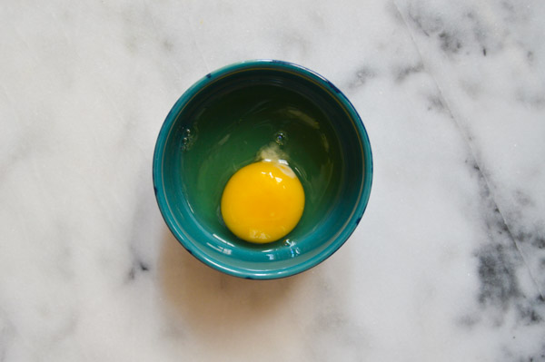 Tips for Better Baking - Crack eggs into a dark bowl to easily spot pieces of shell | www.TheHungryTravelerBlog.com