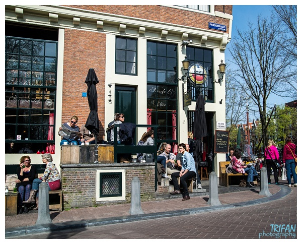 Enjoying a sunny day on the patio at Cafe Papeneiland | Eating Amsterdam Food Tour - Jordaan Food and Canals Tour
