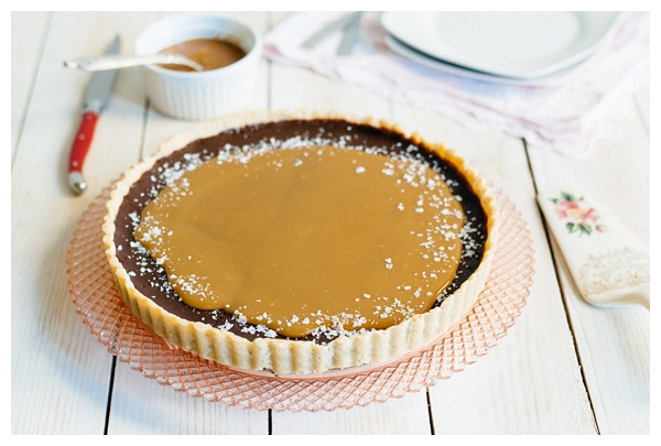 The French Salted Caramel Chocolate Tart on a decorative cake stand