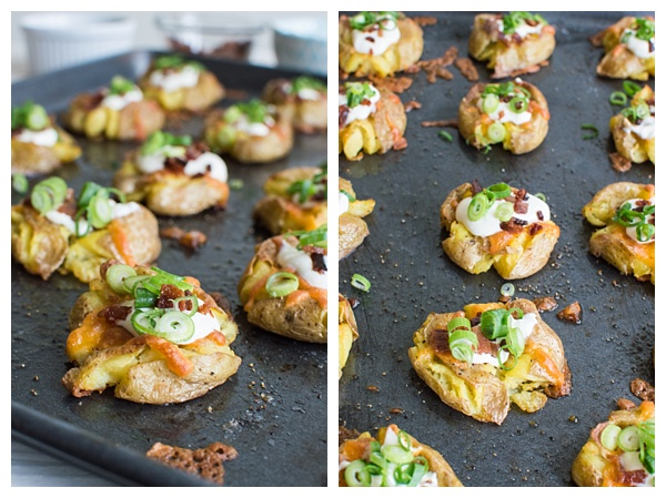 Loaded Smashed Potatoes -- crispy smashed potatoes topped with cheddar cheese, bacon, sour cream, and scallions. A fun side dish or perfect party appetizer!
