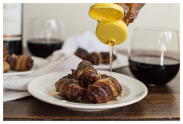 Bacon-Wrapped Dates -- Dates are stuffed with Manchego cheese and slivered almonds, then wrapped in bacon and drizzled with honey. Perfect party appetizer!