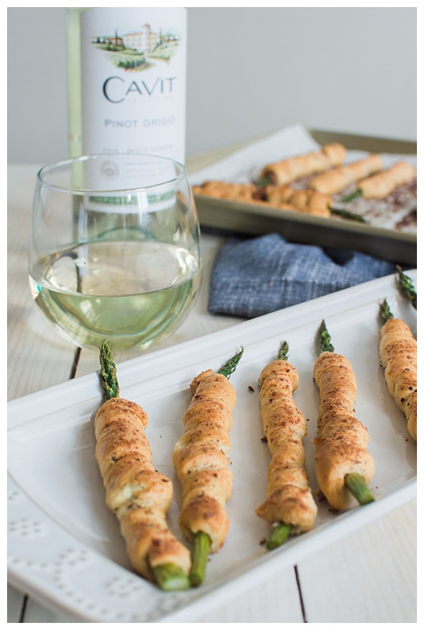 Asparagus Bundles -- Asparagus stalks wrapped in prosciutto, filled with garlic-herb cheese, rolled in crescent dough, topped with Parmesan and baked. A great appetizer, small bite or side dish!