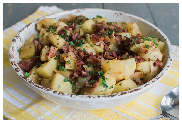 German Potato Salad is a sweet and sour potato salad with bacon, onion and fresh herbs. It's best served warm or at room temperature.