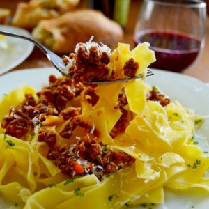 Ragu Alla Bolognese - the classic slow-cooked Italian meat sauce made from a trio of pork, beef, and proscuitto. | www.TheHungryTravelerBlog.com