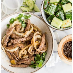 Stir-Fried Beef with Black Pepper is an easy stir-fry made with coarsely cracked black pepper, onions, and oyster sauce. Serve with rice and a cucumber salad for wonderful authentic Chinese meal!