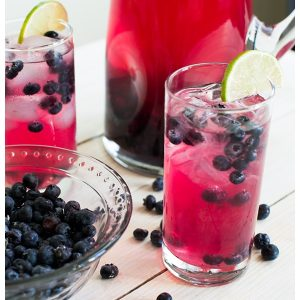 Sparkling Blueberry Lime Tequila Punch is a festive cocktail to serve at any holiday party. With only 5 ingredients, mix up a big batch and enjoy the party!